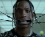 "Travis Scott gets stoned, surreal and cyborg-esque in his video for ""Highest In The Room"""
